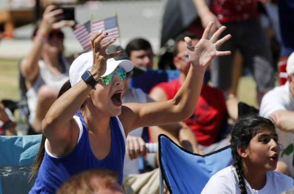 Photo -  Nassil Al Adhami, left, reacts Sunday as Megan Rapinoe scores a goal for the U.S. on a penalty kick in the 61st minute during a watch party hosted by the OKC Energy FC for the final match of the FIFA Women's World Cup between the U.S. Women's National Team and the Netherlands, at Together Square, 400 W. Sheridan Ave., in Oklahoma City. The United States won 2-0. [Nate Billings/The Oklahoman]
