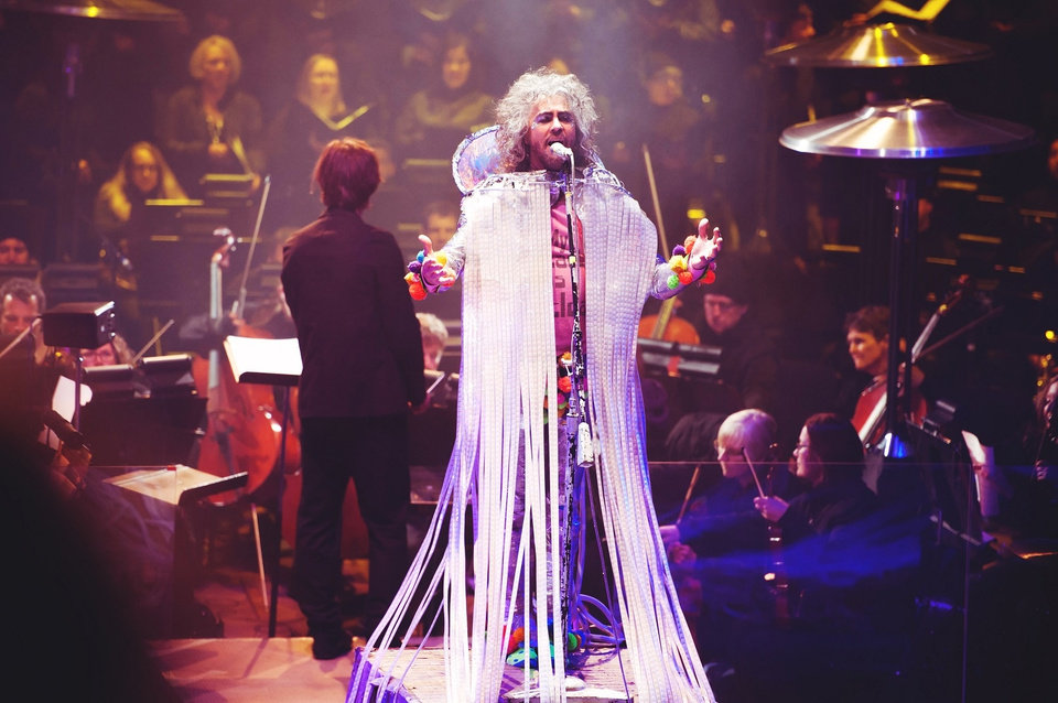 "Photo -  The Flaming Lips' Wayne Coyne performs ""The Soft Bulletin"" live in 2016 at Red Rocks Amphitheater in Morrison, Colorado, with the Colorado Symphony Orchestra. [PhotoS by Shannon Shumaker]"