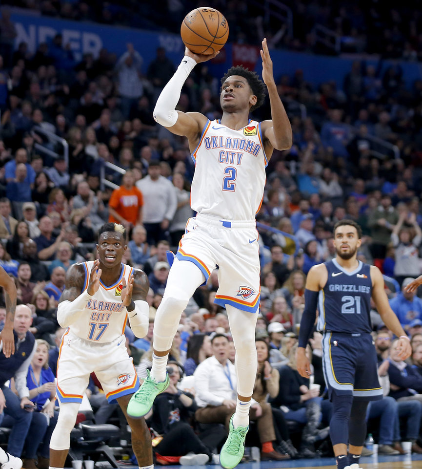 Photo - Oklahoma City's Shai Gilgeous-Alexander (2) makes a basket at the end of the 3rd quarter during an NBA basketball game between the Oklahoma City Thunder and the Memphis Grizzlies at Chesapeake Energy Arena in Oklahoma City, Wednesday, Dec. 18, 2019. Oklahoma City won 126-122. [Bryan Terry/The Oklahoman]