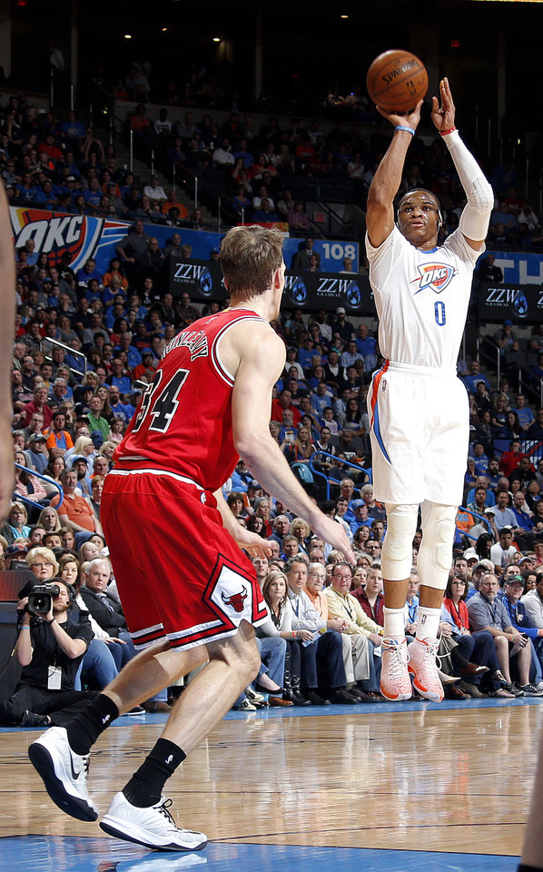 Photo - Oklahoma City's Russell Westbrook (0) shoots over Chicago's Mike Dunleavy (34) during the NBA game between the Oklahoma City Thunder and the Chicago Bulls at Chesapeake Energy Arena in Oklahoma City, Sunday, March  15, 2015. Photo by Sarah Phipps, The Oklahoman