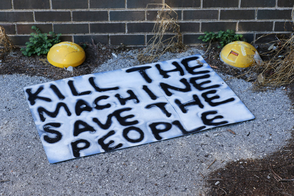Photo - Sign left from the protest across the street from the Oklahoma City Police Department Damage from Saturday night protest in downtown Oklahoma City, Sunday, May 31, 2020. [Doug Hoke/The Oklahoman]
