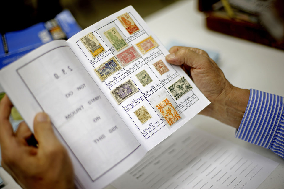Oklahoma City Stamp Club Members Look Through Philatelic Society Books Before A Meeting Photo By Bryan Terry The Oklahoman