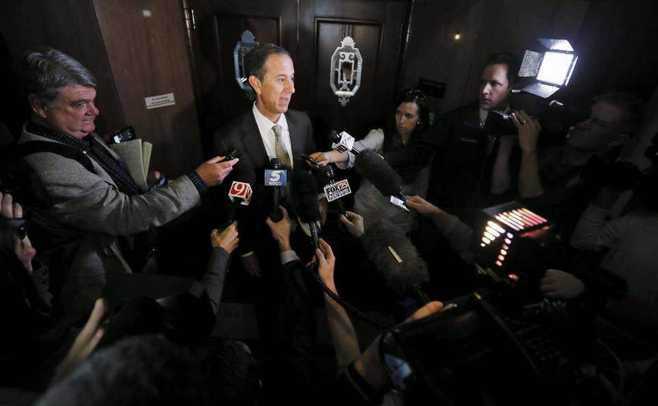 Photo - Oklahoma Secondary School Activities Association (OSSAA) attorney Mark Grossman speaks to the media after an injunction hearing on the Douglass-Locust Grove football controversy at the Oklahoma County Courthouse in Oklahoma City, Wednesday, Dec. 10, 2014. Photo by Nate Billings, The Oklahoman