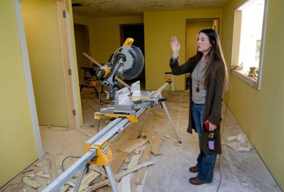 Photo -  Jamie Zumwalt talks about the features in the new Joe's Addiction coffee shop that will open soon at 1725 SE 59. [Chris Landsberger/The Oklahoman]