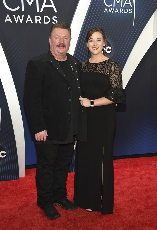 Photo - Joe Diffie, left, and Theresa Crump arrive at the 52nd annual CMA Awards at Bridgestone Arena on Wednesday, Nov. 14, 2018, in Nashville, Tenn. (Photo by Evan Agostini/Invision/AP)