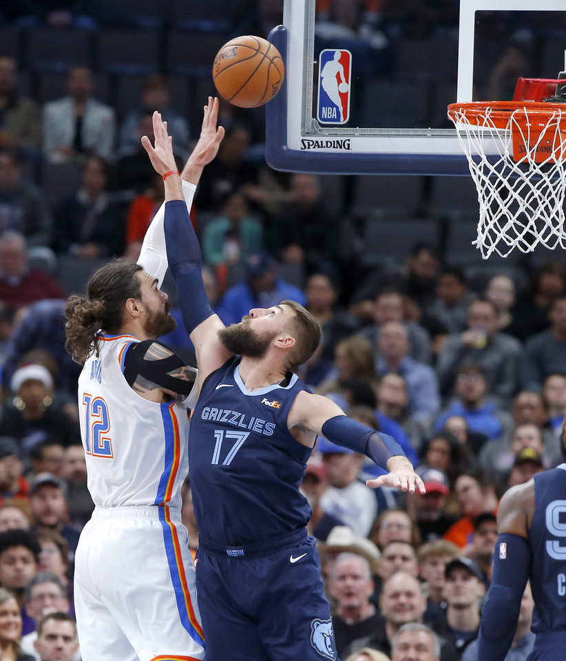 Photo - Oklahoma City's Steven Adams (12) shoots over Memphis' Jonas Valanciunas (17) during an NBA basketball game between the Oklahoma City Thunder and the Memphis Grizzlies at Chesapeake Energy Arena in Oklahoma City, Wednesday, Dec. 18, 2019. [Bryan Terry/The Oklahoman]
