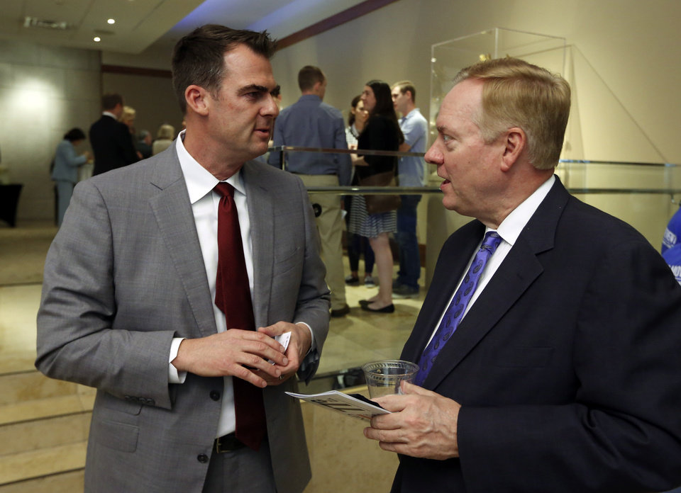 Photo - Republican gubernatorial candidate Kevin Stitt, left, speaks with Tom Simonson before participating in a forum for candidates at the Oklahoma City Museum of Art on Monday, April 23, 2018 in Oklahoma City, Okla.  Photo by Steve Sisney, The Oklahoman