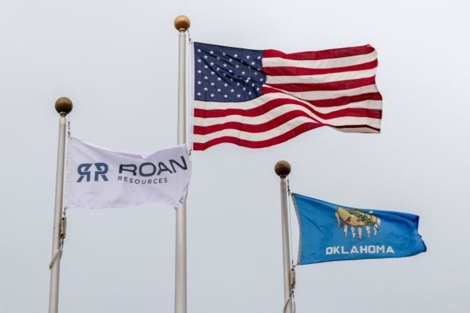 Photo -  Flags fly in front of Roan Resources' Oklahoma City headquarters. [The Oklahoman Archives]