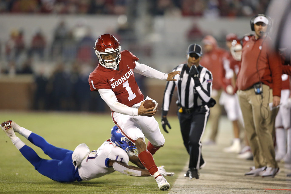 Photo - Oklahoma's Kyler Murray (1) runs for a first down past Kansas' Mike Lee (11) during a college football game between the University of Oklahoma Sooners (OU) and the Kansas Jayhawks (KU) at Gaylord Family-Oklahoma Memorial Stadium in Norman, Okla., Saturday, Nov. 17, 2018. Photo by Bryan Terry, The Oklahoman