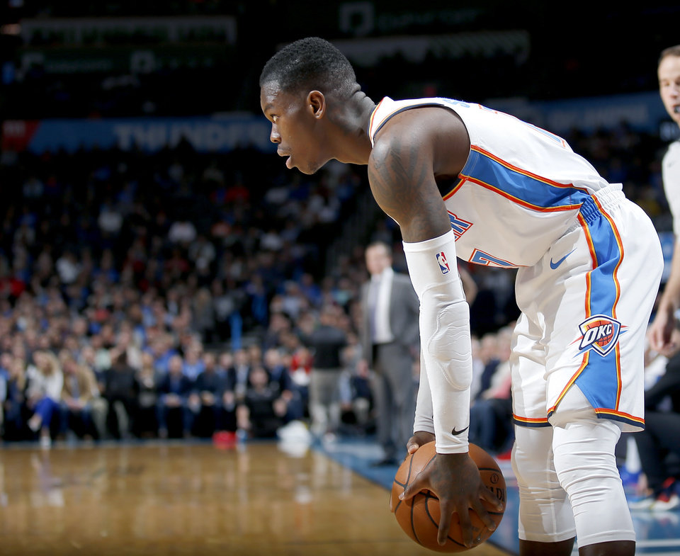 Photo - Oklahoma City's Dennis Schroder (17) looks to get by a defender during the NBA basketball game between the Oklahoma City Thunder and the Portland Trail Blazers at Chesapeake Energy Arena in Oklahoma City, Tuesday, Jan. 22, 2019. Photo by Sarah Phipps, The Oklahoman
