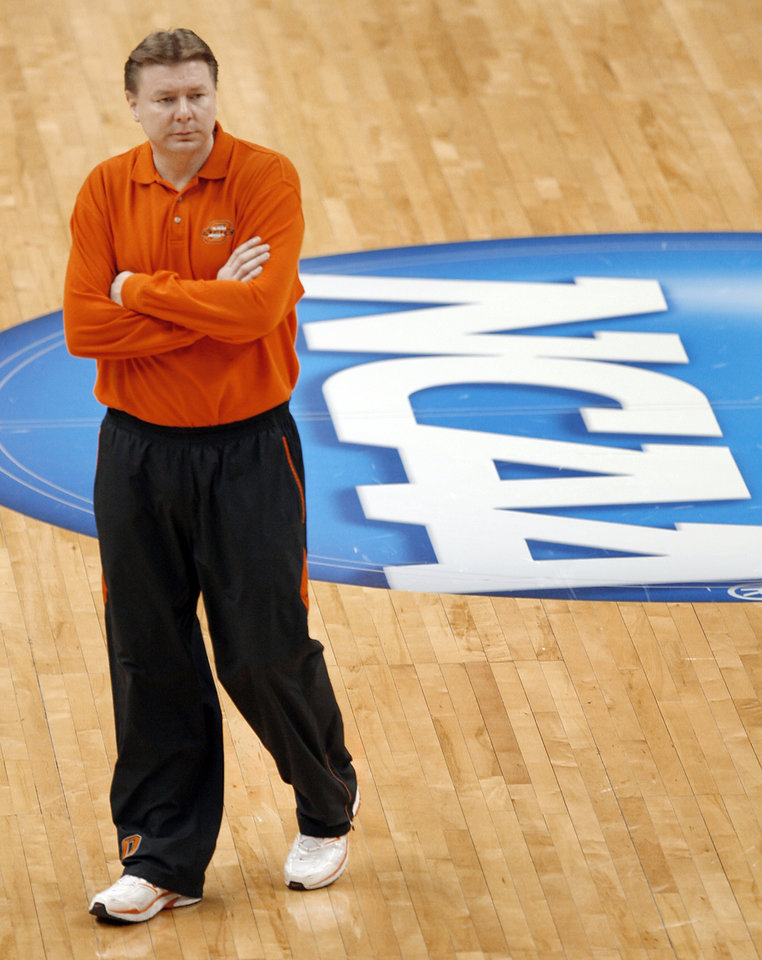 Photo - Oklahoma State University coach Kurt Budke watches his Cowgirls during practice day for the first round of the women's NCAA basketball tournament in the Jack Breslin Arena at Michigan State University on Saturday, March 17, 2007, in East Lansing, Mich.   staff photo by CHRIS LANDSBERGER