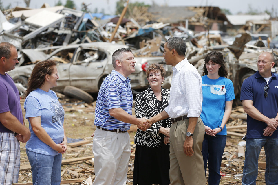 Photo - President Barack Obama greets tornado victims at Plaza Towers Elementary in Moore, Okla., on Sunday, May 25, 2013. Photo by Bryan Terry The Oklahoman