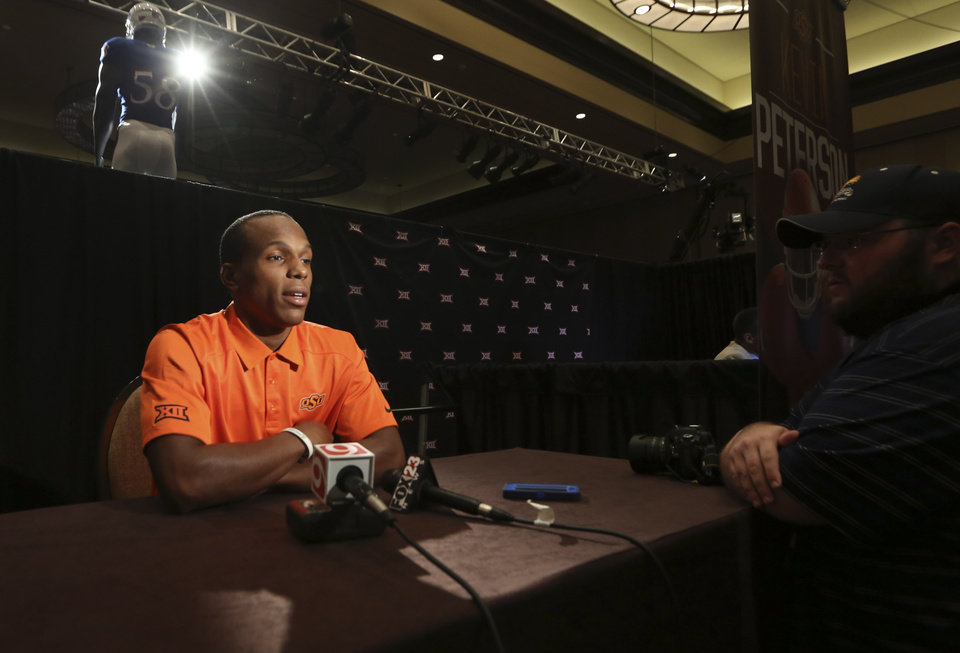 Photo - Oklahoma State corner back Kevin Peterson speaks to reporters during the NCAA college Big 12 Conference football media days in  Dallas, Monday, July 21, 2014. (AP Photo/LM Otero)