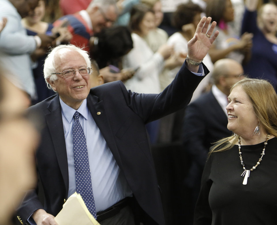 Photo -  Bernie Sanders waves at an Oklahoma City rally at the Cox Convention Center in February. [Photo by Doug Hoke, The Oklahoman Archives]