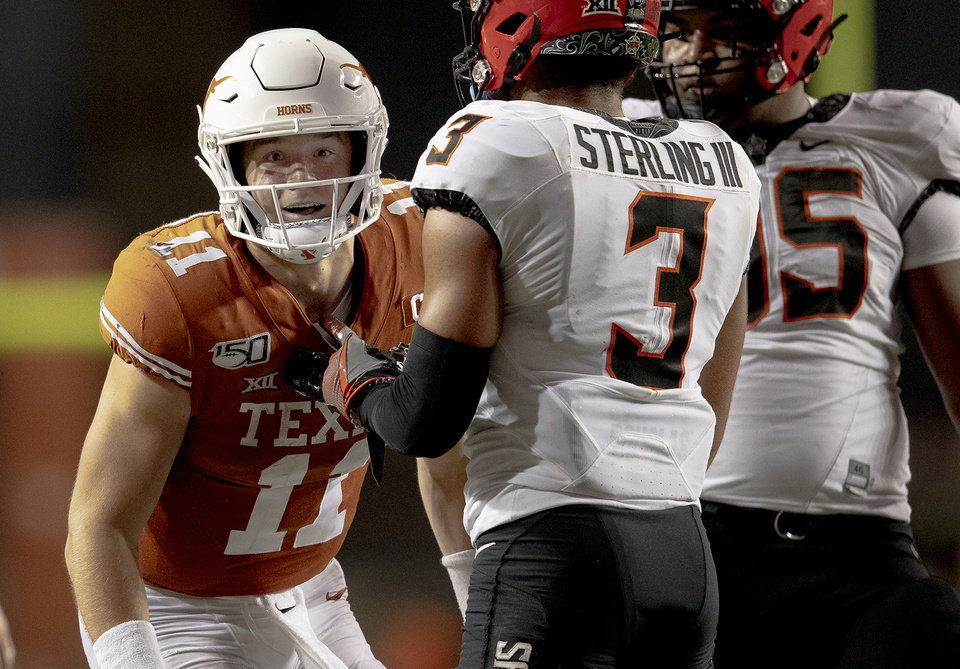 Photo - Texas quarterback Sam Ehlinger (11) smiles after gaining a first down to seal the win against Oklahoma State during an NCAA college football game Saturday, Sept. 21, 2019, in Austin, Texas. (Nick Wagner/Austin American-Statesman via AP)
