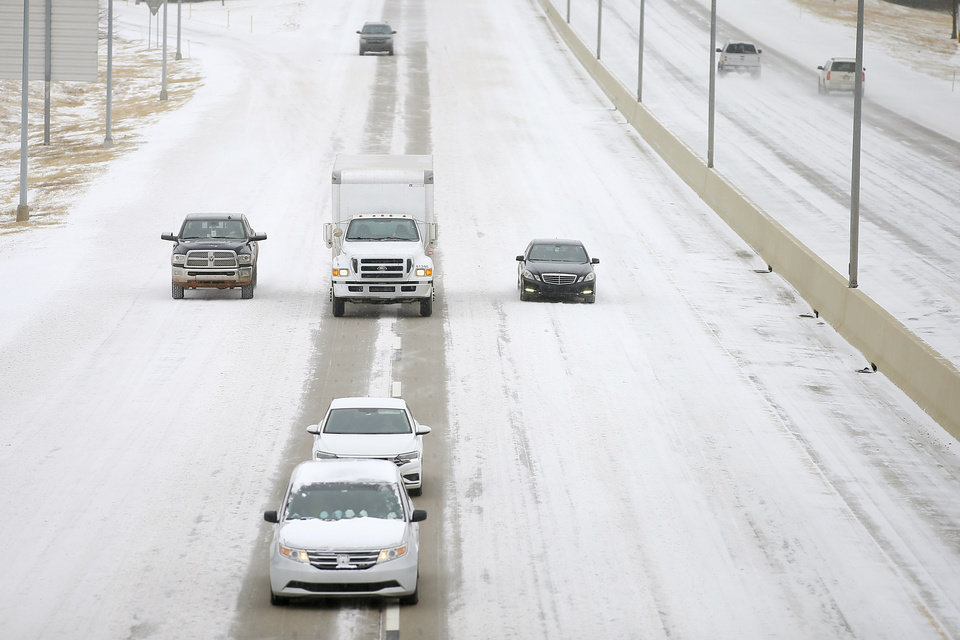 Photo - Vehicles travels west along the John Kilpatrick Turnpike during a winter storm in Oklahoma City, Sunday, Feb. 14, 2021. [Bryan Terry/The Oklahoman]