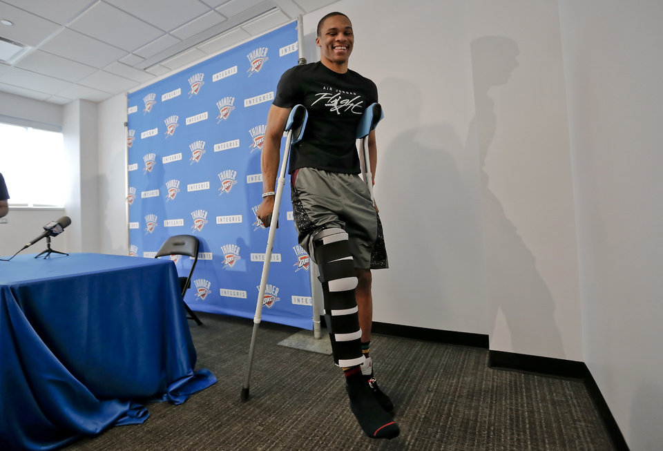 Photo -  Russell Westbrook leaves a press conference on May 9, 2013, where he talked about a knee injury suffered in a playoff series against Houston. [Photo by Chris Landsberger, The Oklahoman]