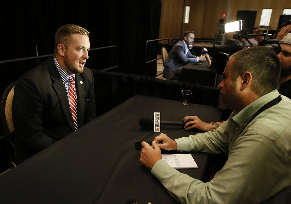Photo - Texas Tech offensive lineman Jared Kaster talks with reporters during Big 12 Conference Football Media Days Monday, July 20, 2015, in Dallas. (AP Photo/Tony Gutierrez)