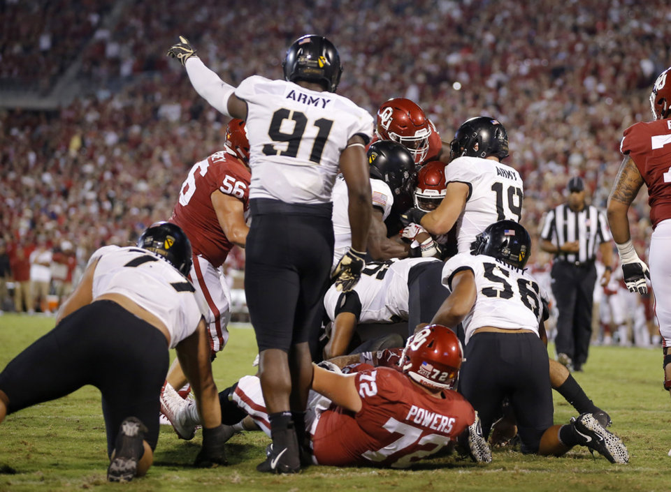 Photo - Oklahoma's Trey Sermon (4) is stopped on fourth down at the goal line during a college football game between the University of Oklahoma Sooners (OU) and the Army Black Knights at Gaylord Family-Oklahoma Memorial Stadium in Norman, Okla., Saturday, Sept. 22, 2018. Photo by Bryan Terry, The Oklahoman
