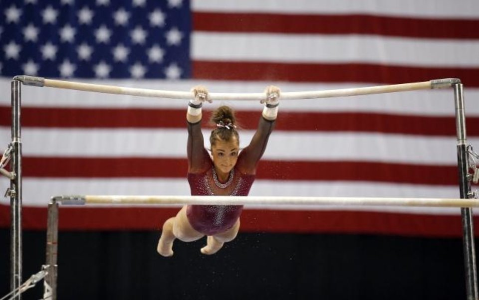 Photo -  OU's Maggie Nichols performs on the uneven bars during Perfect 10 Challenge at Cox Convention Center on Feb. 15, 2019. [Sarah Phipps/The Oklahoman]