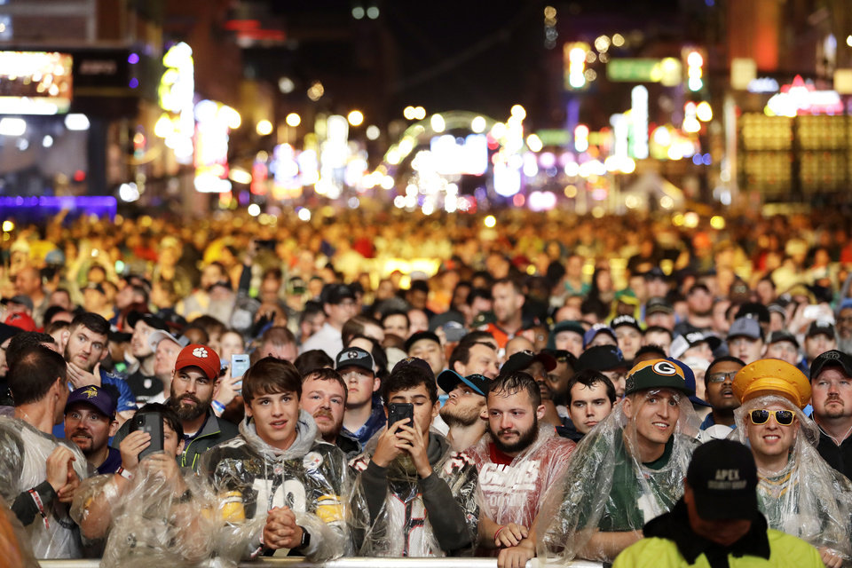 Photo - Spectators watch gthe main stage during the first round at the NFL football draft, Thursday, April 25, 2019, in Nashville, Tenn. (AP Photo/Steve Helber)