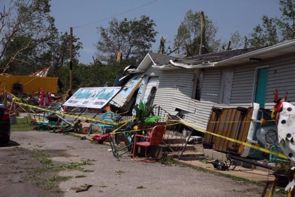 Photo -  Damage from storms was evident Wednesday in Haileyville. [HARRISON GRIMWOOD/Tulsa World]