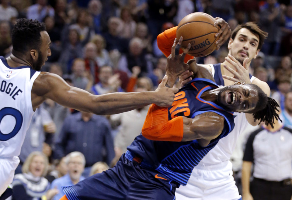 Photo - Oklahoma City's Nerlens Noel (3) gets a rebound from Minnesota's Josh Okogie (20) during the NBA game between the Oklahoma City Thunder and the Minnesota Timberwolves at the Chesapeake Energy Arena,  Sunday, Dec. 23, 2018. Photo by Sarah Phipps, The Oklahoman