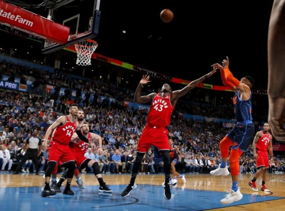 Photo -  Oklahoma City's Russell Westbrook, right, shoots over Toronto's Pascal Siakam during Wednesday night's game at Chesapeake Energy Arena. [Sarah Phipps/The Oklahoman]