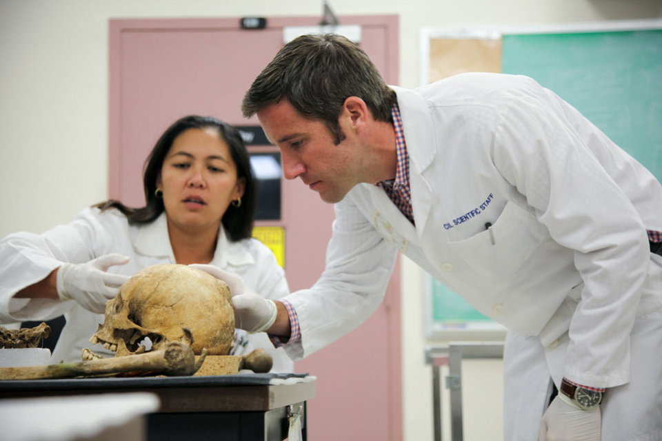 Photo - Denise To and Sean Tallman are seen examining remains in the Joint POW/MIA Accounting Command's Central Identification Laboratory. Photo Provided  PROVIDED