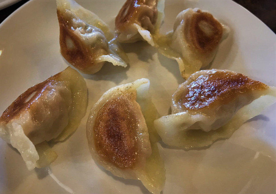 Photo - Pork pot stickers from Northern Noodle House in Oklahoma City. [Dave Cathey/The Oklahoman]