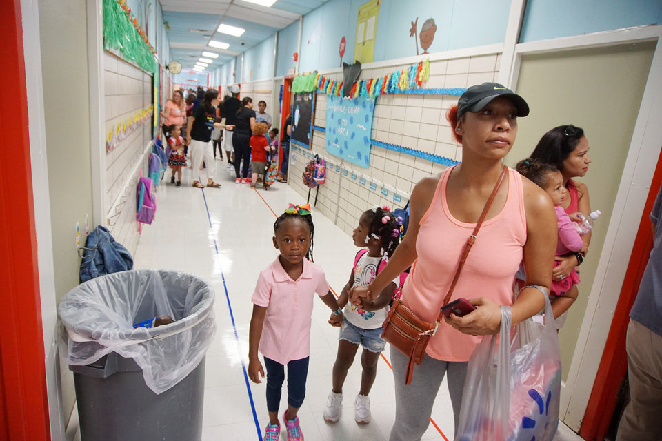 Photo -  Chanell Manuel walks her daughter to her classroom on the first day of school at The Learning Tree prekindergarten school in Lawton. [Photo by Ben Felder, The Oklahoman]