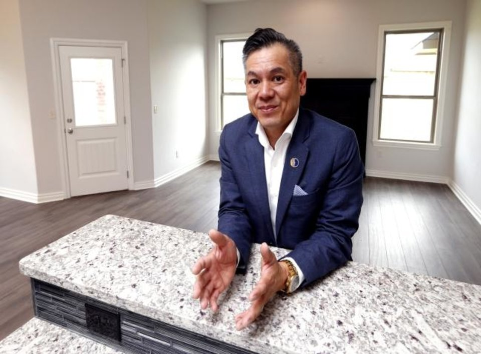 Photo -  Realtor Derrick Tran shows a house on SW 96 last fall. Tran, who is Asian, is passionate about helping Asians become homeowners. [OKLAHOMAN ARCHIVES]