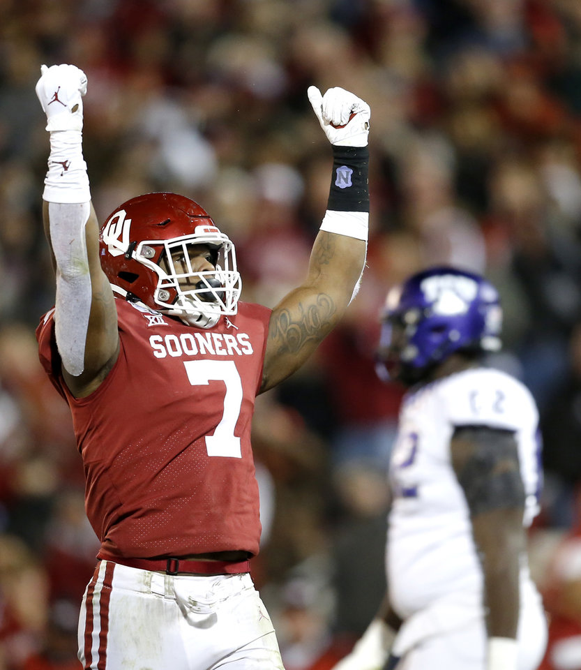 Photo - Oklahoma's Ronnie Perkins (7) celebrates a play in the fourth quarter during an NCAA football game between the University of Oklahoma Sooners (OU) and the TCU Horned Frogs at Gaylord Family-Oklahoma Memorial Stadium in Norman, Okla., Saturday, Nov. 23, 2019. OU won 28-24. [Sarah Phipps/The Oklahoman]