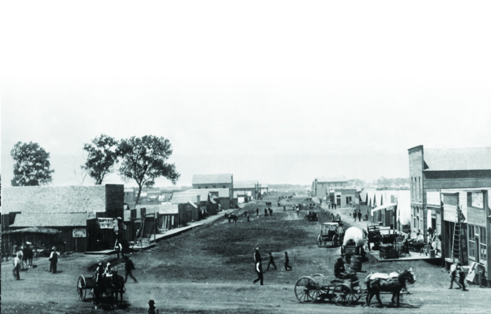Photo -  Downtown Oklahoma City's Grand Avenue, now known as Sheridan Avenue, is shown in this May 22, 1889, photograph by P.A. Miller. [PHOTO PROVIDED]