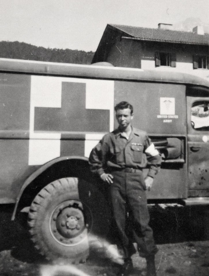 Photo -  Clayton Barnwell stands in front of an ambulance. [Photo provided]