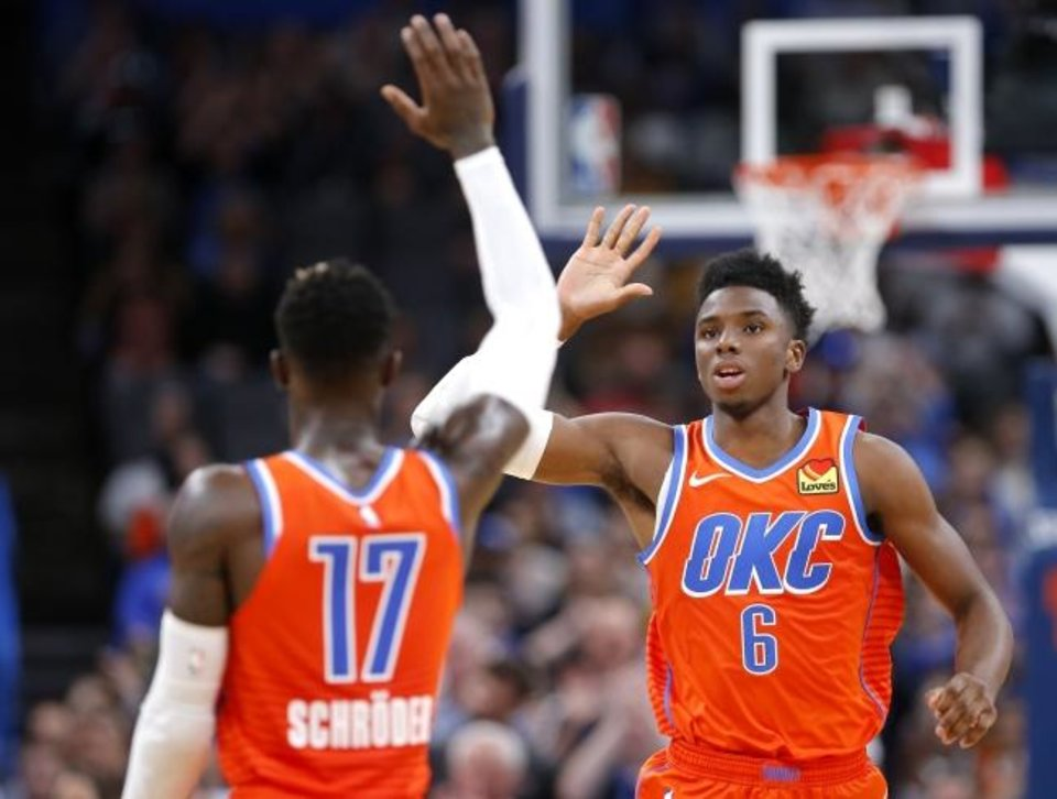 Photo -  Oklahoma City's Dennis Schroder and Hamidou Diallo are key pieces to a bench that is helping the surprising Thunder through the first half of the season. [Sarah Phipps/The Oklahoman]