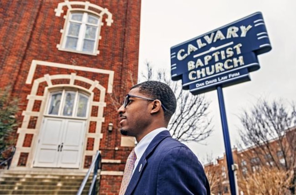 Photo -  J.D. Baker walks in front of the former Calvary Baptist Church. The special assistant to Mayor David Holt said he got his start in public speaking through church. [Chris Landsberger, The Oklahoman]
