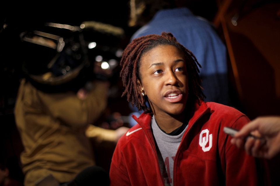 Photo - OU's Danielle Robinson is interviewed in the locker room in Kansas City, Mo., on Monday, March 29, 2010. Oklahoma will play Kentucky in the regional championship game of the NCAA women's tournament on Tuesday, March 29, 2010.