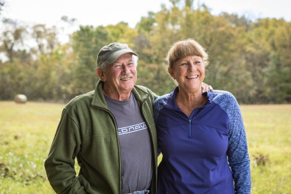 Photo - Don and Gale Mace are all smiles after their land was restored by OERB. (Photo provided by OERB)