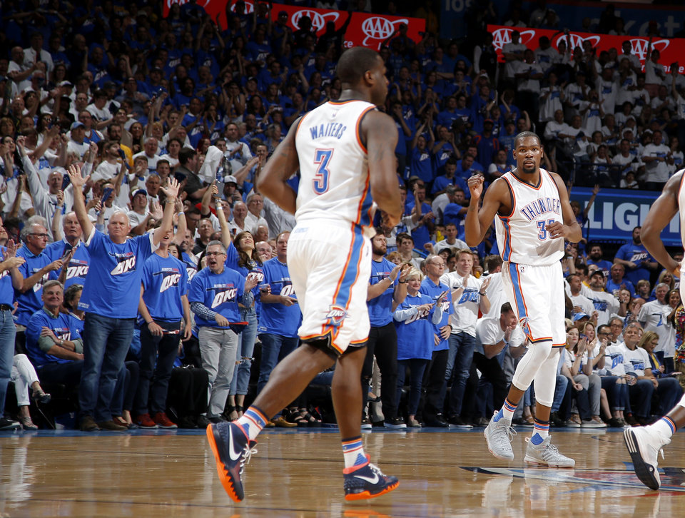 Photo - Oklahoma City's Kevin Durant (35) celebrates after a Thunder basket during Game 3 of the Western Conference finals in the NBA playoffs between the Oklahoma City Thunder and the Golden State Warriors at Chesapeake Energy Arena in Oklahoma City, Sunday, May 22, 2016. Photo by Bryan Terry, The Oklahoman