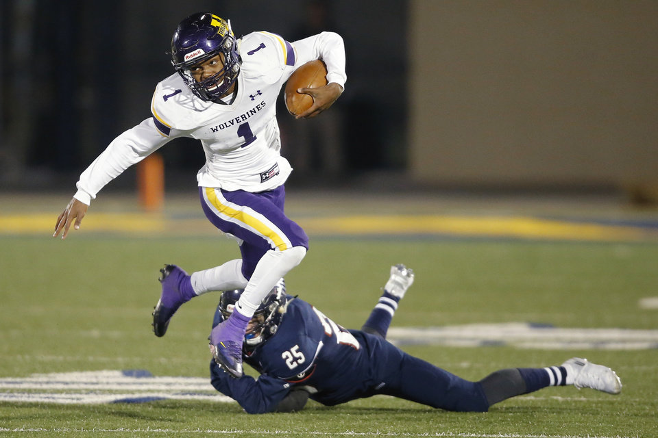 Photo - Vian's Javyn Wright leaps over  Tulsa Metro Christian's Tag Campbel during the Class 2A football state championship game between Tulsa Metro Christian and Vian at Wantland Stadium in Edmond, Okla., Saturday, Dec. 14, 2019. [Bryan Terry/The Oklahoman]