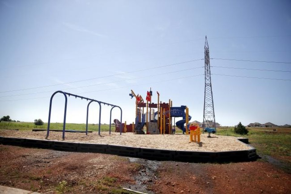 Photo -  Playground equipment is pictured at a new housing development in northwest Oklahoma City at NW 150 and Council Road.