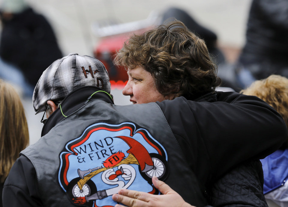 Photo - Kari Watkins, executive director, Oklahoma City National Memorial & Museum, talks to Oklahoma City Fire Chief Keith Bryant as they watch riders arrive at the memorial. Motorcyclists from across the country, numbering more than 1,000 strong, rumbled through the downtown streets of Oklahoma City on Saturday, April, 22, 2017,  taking part in  the 10th annual Ride to Remember.  The annual benefit run honors the 168 people killed in the April 19, 1995 bombing of the Alfred P. Murrah Federal Building. All funds raised go toward the Oklahoma City National Memorial and Museum, which operates solely on private donations. Bikers rolled out for the first event in 2007.    Photo by Jim Beckel, The Oklahoman