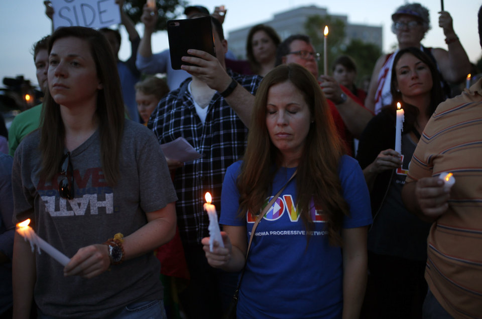 Photo - People hold candles during an Oklahoma Standing in Solidarity with Charlottesville Rally at the Oklahoma state Capitol in Oklahoma City,  Sunday, Aug. 13, 2017. Photo by Sarah Phipps, The Oklahoman