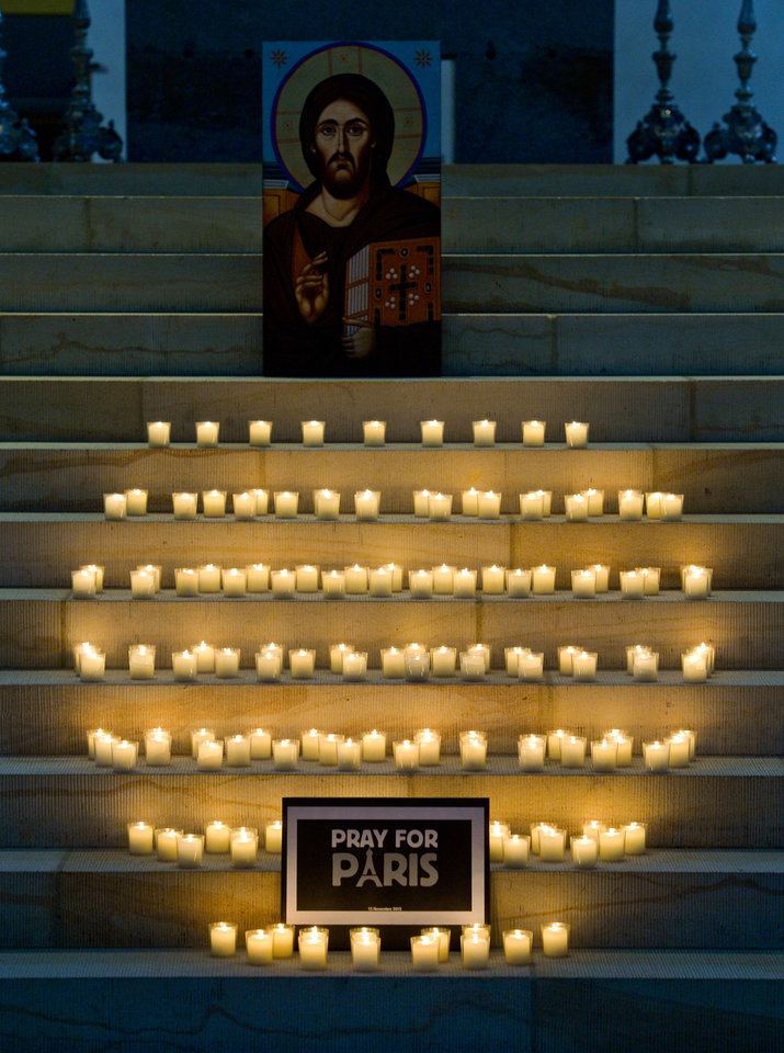 Photo - Candles are  placed  for  victims of the Paris attacks Friday night,   in front of the Hildesheim cathedral in Hildesheim northern Germany, Saturday, Nov. 14, 2015.  French President Francois Hollande said more than 120 people died Friday night in shootings at Paris cafes, suicide bombings near France's national stadium and a hostage-taking slaughter inside a concert hall. (Peter Steffen/dpa via AP)