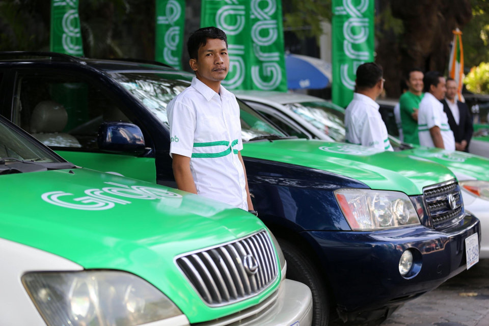 Photo - Toyota is placing a big bet on Southeast Asia's largest ride-hailing company.