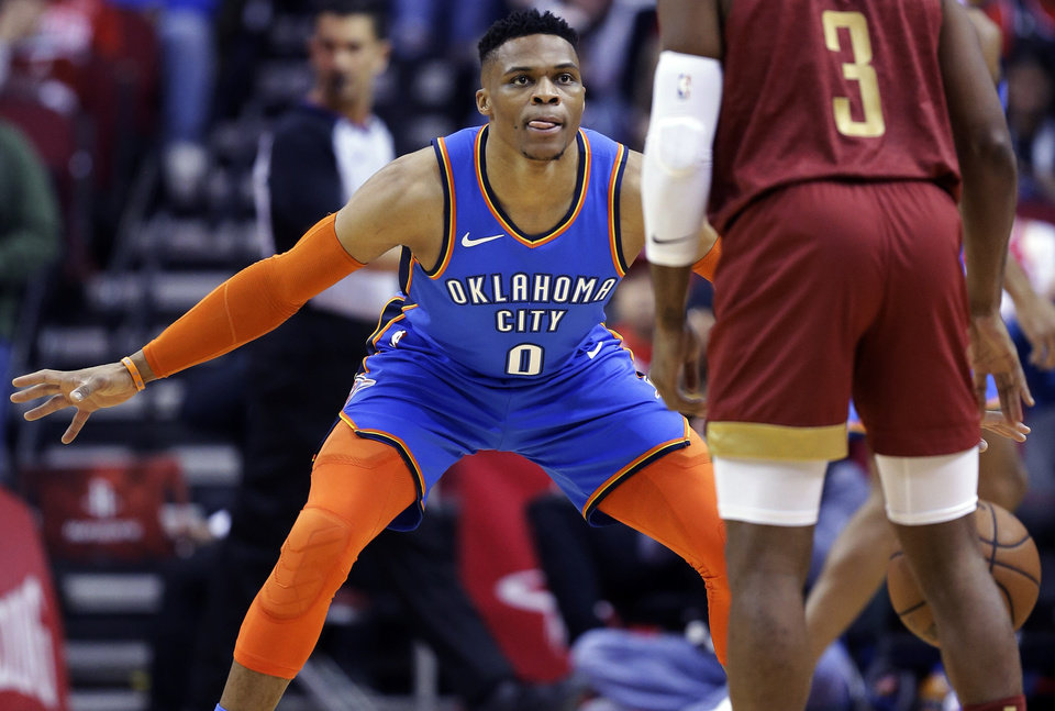 Photo - Oklahoma City Thunder guard Russell Westbrook, left, defends Houston Rockets guard Chris Paul during the first half of an NBA basketball game, Saturday, Feb. 9, 2019, in Houston. (AP Photo/Eric Christian Smith)