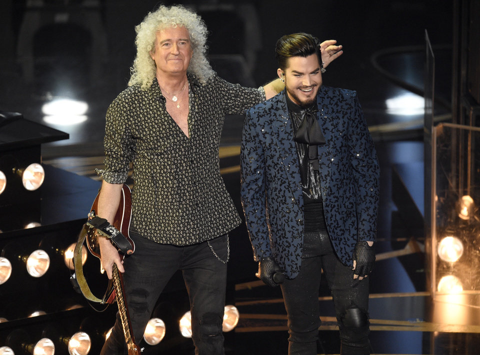 Photo -  Adam Lambert, right, and Brian May of Queen acknowledge the audience after a performance at the Oscars on Sunday, Feb. 24, 2019, at the Dolby Theatre in Los Angeles. (Photo by Chris Pizzello/Invision/AP)