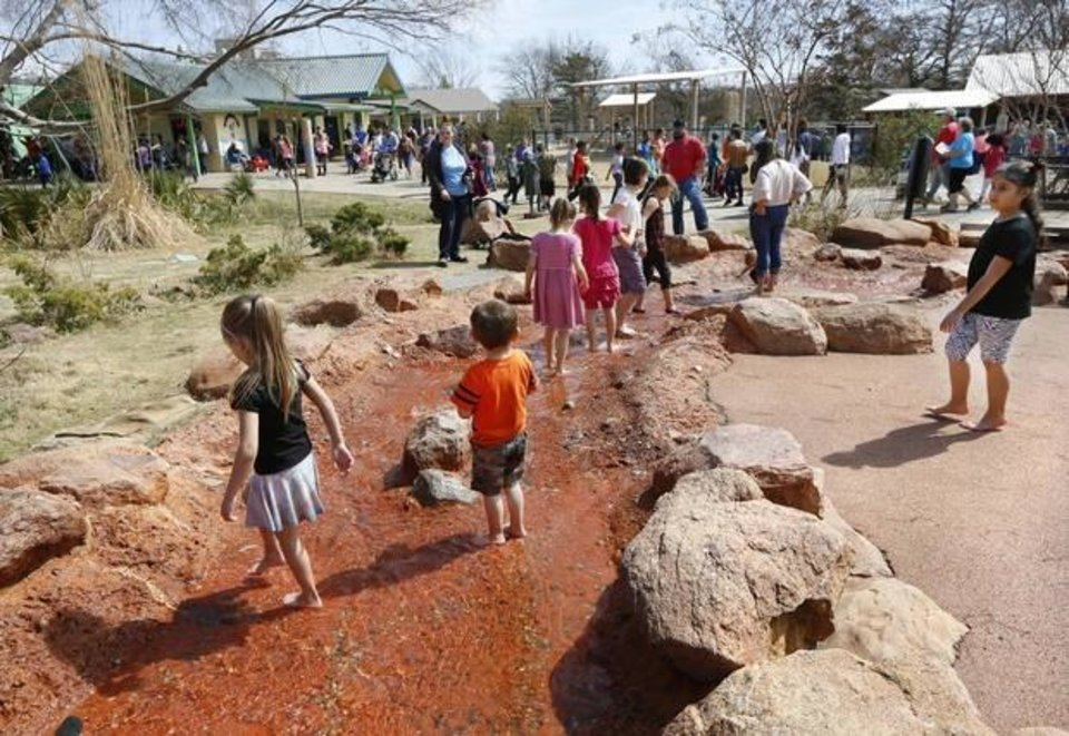 Photo -  Visitors play in the Children's Zoo area during spring break 2018 on Wednesday, March 21, 2018. [The Oklahoman Archives]
