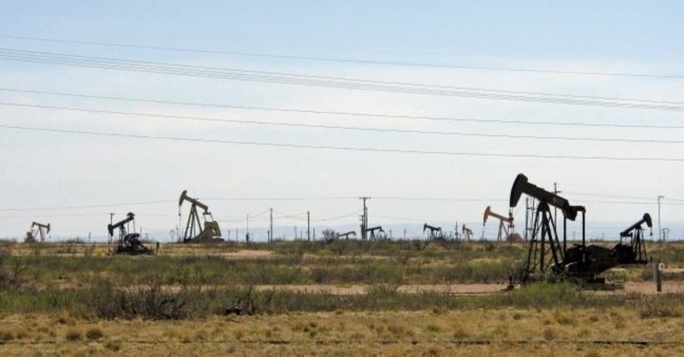 Photo -  Pump jacks produce oil from the Permian Basin near Artesia, New Mexico in 2014. [AP Photo/Jeri Clausing, File]